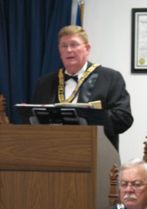MW Flora presents his message to the Brethren of District 2
